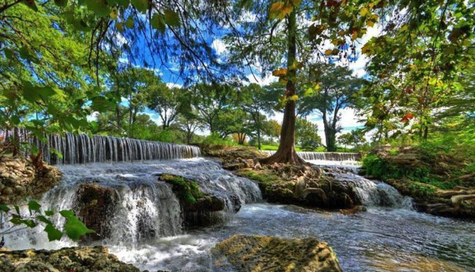 water flowing in a lush green area