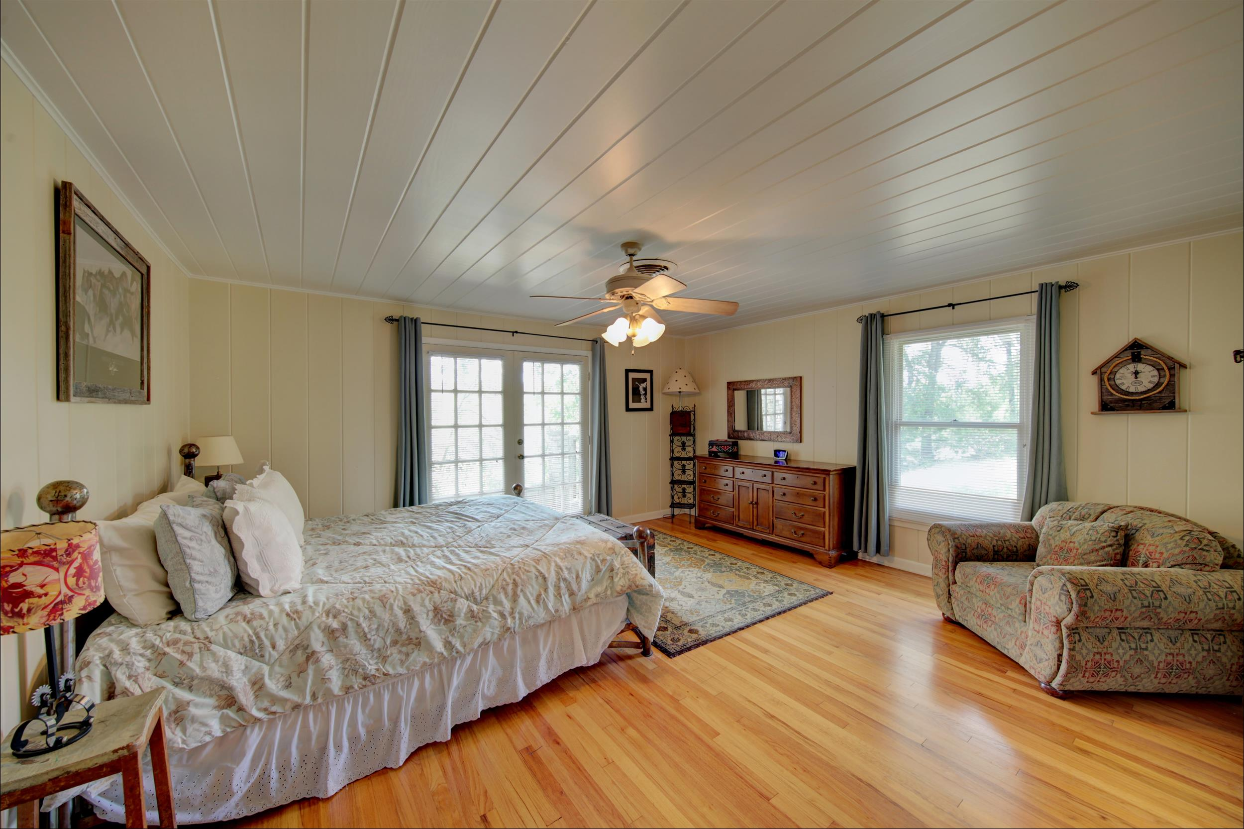 a bedroom with wood floors